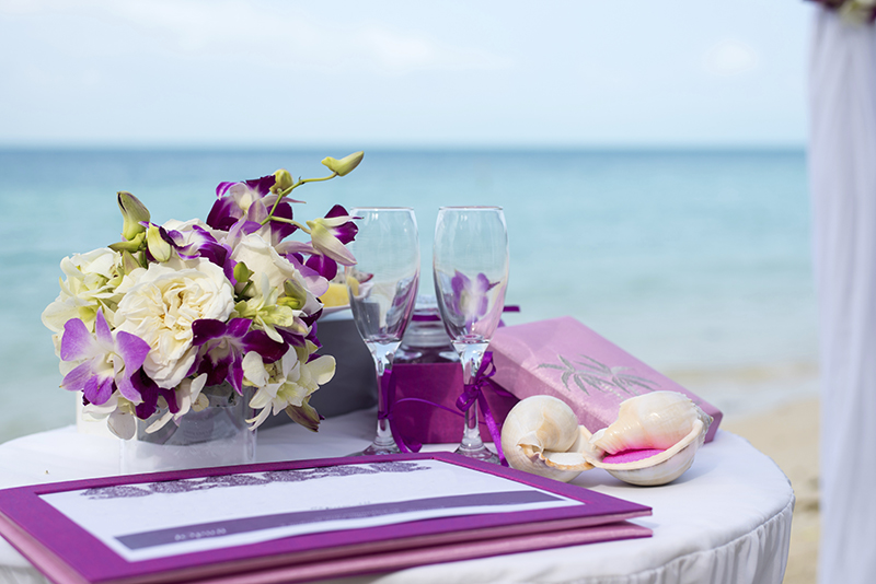 A table on the beach with a wedding decoration